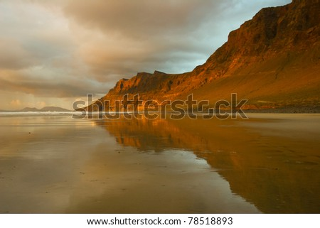 The beach at twilight in Lanzarote, Canary Islands - stock photo