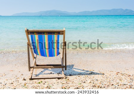 The beach chairs on background of sea