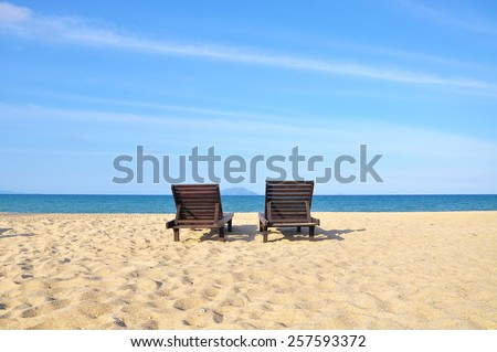 The beach chairs on sand beach. Concept for rest, relaxation, holidays, spa, resort with copy space area. - stock photo