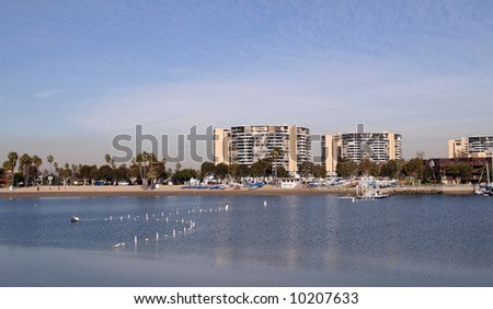 The Beach in Marina del Rey. Marina Del Rey in Los Angeles is the largest man-made small boat harbor in the world with about 7000 pleasure boats and yachts.