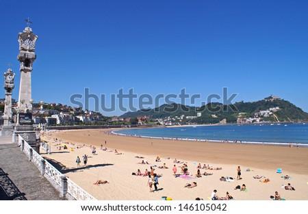 The beach in San Sebastian on a sunny summer day - stock photo