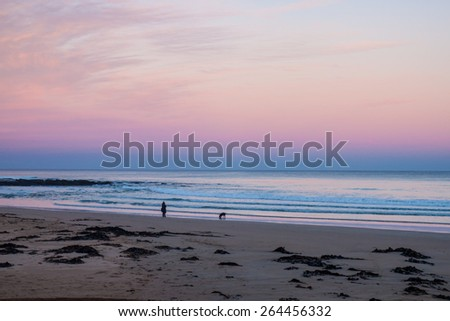 The beach in the sunset - stock photo