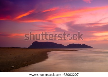 The beach, mountain and with dramatic sunrise sky - stock photo