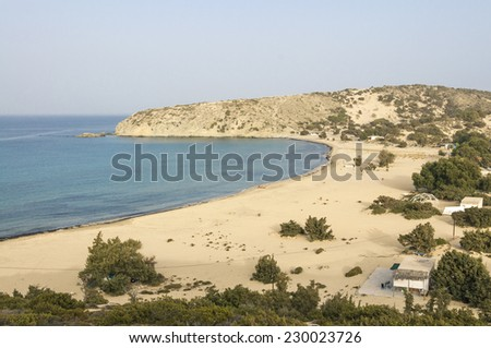 The Beach of Sarakiniko on Gavdos. Gavdos is the southernmost island in Greece. Sarakiniko has a dreamy beach with crystal clear shallow waters, hidden in a wild landscape of dunes and junipers. - stock photo