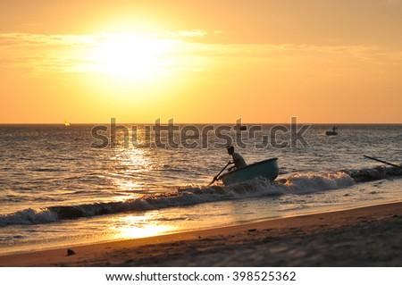 The beach with fishing boats and fishers of Mui Ne, Vietnam - stock photo