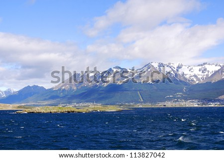 The Beagle Channel Patagonia Argentina develops between several islands; to the north lies Argentine-Chilean Isla Grande de Tierra del Fuego, to the south Hoste, Navarino, and Picton and Nueva. - stock photo