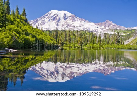 The Beautful Reflection of Mt Rainier from the Bench Lake - stock photo
