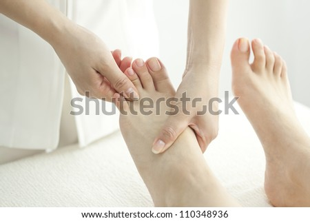The beautician who massages the foot - stock photo