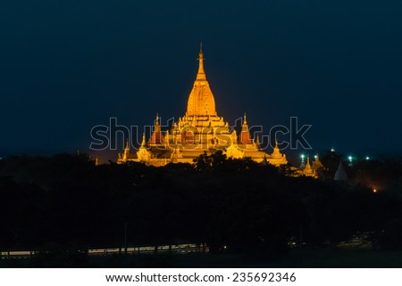 The beautiful Ananada Temple in Bagan in Myanmar, built in the year 1105 using architectural elements from Mon and Indian styles, at sunset - stock photo
