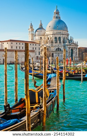The beautiful and famous tourist destination spot Basilica Santa Maria della Salute in sunny weather on the Grand Canal, the best place in Venice, Italy - stock photo