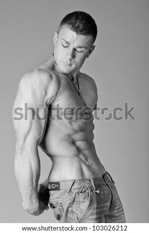 The beautiful and strong young guy - stock photo