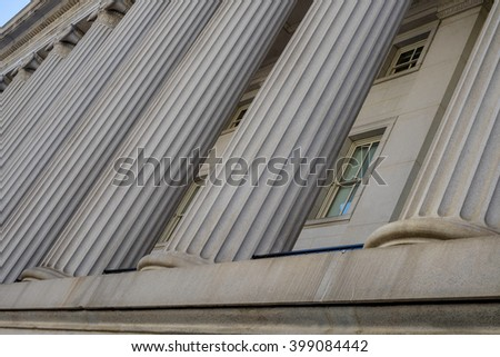 The beautiful architecture columns of the Treasury Department in Washington DC - stock photo