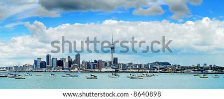 The beautiful Auckland skyline with white fluffy clouds... - stock photo