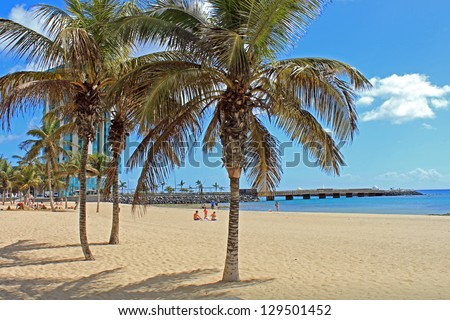 The beautiful beach at Arrecife city in the Canary Islands. - stock photo