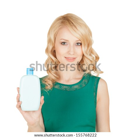 the beautiful blonde holds in a hand a bottle cosmetics - stock photo