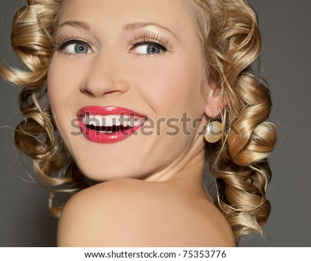 The beautiful blonde  woman with bright red lipstick - stock photo