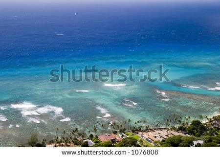 The beautiful blue ocean off the coast of Diamond Head volcano. - stock photo