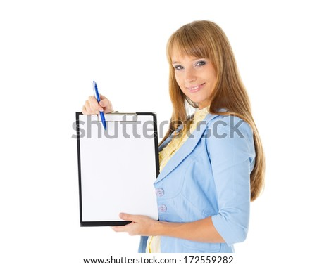 The beautiful businesswoman showing a blank clipboard stands on a white background. - stock photo