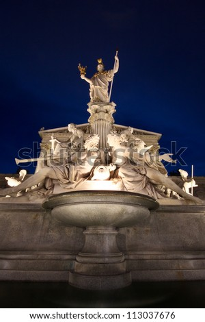The beautiful fountain of Athena in front of the Austrian Parliament in Vienna, by night - stock photo