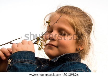 The beautiful girl among flowers. Isolated - stock photo