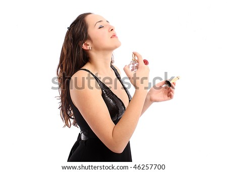 The beautiful girl applying perfume on her body, isolated on white background - stock photo