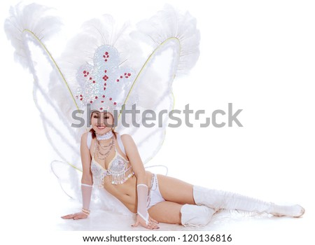 The beautiful girl in a suit for dance sits - stock photo