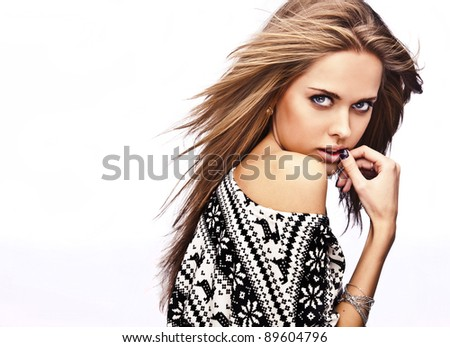 The beautiful girl in a sweater with deer - stock photo