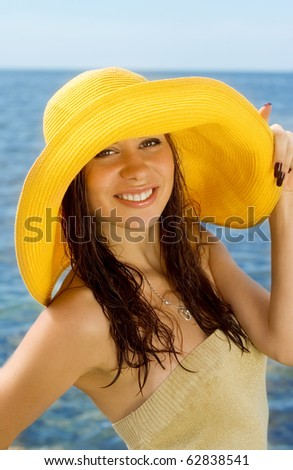 The beautiful girl in a yellow hat