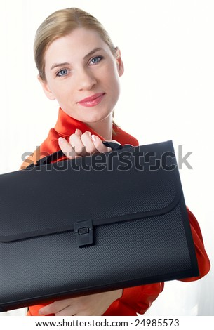 The beautiful girl in red holds in hands a black portfolio