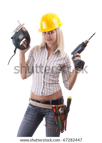 The beautiful girl showing off her carpentry tools - stock photo