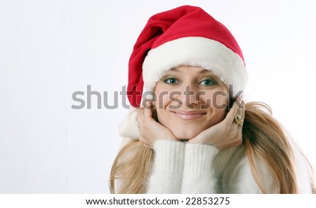 The beautiful girl smiles in a New Year's cap - stock photo