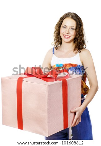 The beautiful girl smiling holds a gift in a box on a white background. - stock photo
