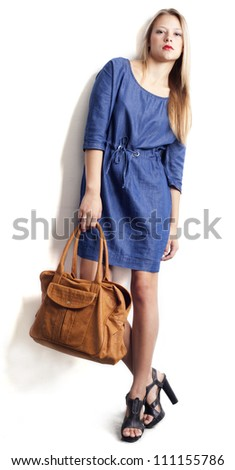 The beautiful girl with a bag. - stock photo