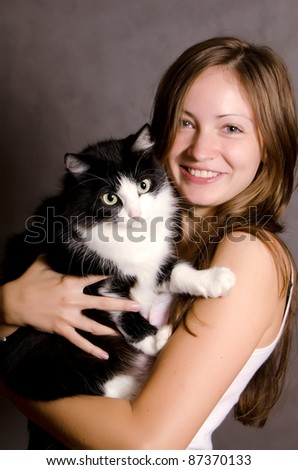 The beautiful girl with a black cat - stock photo