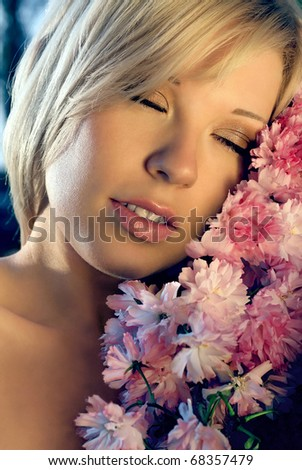 The beautiful girl with a bouquet of pink colors - stock photo