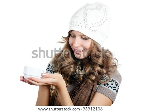 The beautiful girl with a coffee cup - stock photo