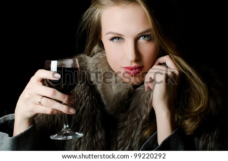 The beautiful girl with a wine glass - stock photo
