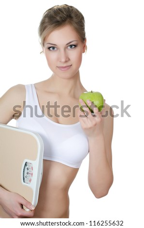 The beautiful girl with apple in hand