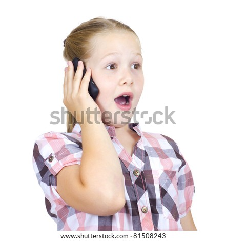 The beautiful girl with astonishment speaks on the phone