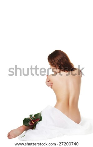 The beautiful girl with flowers touches a body - stock photo