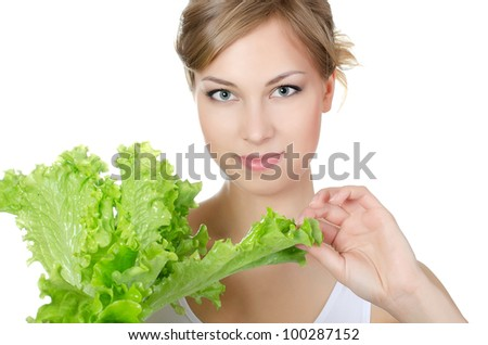 The beautiful girl with green salad isolated - stock photo
