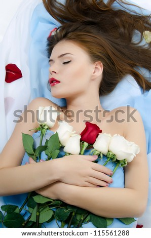The beautiful girl with petals of roses