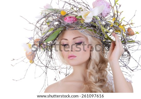 The beautiful girl with wreath from branches - stock photo