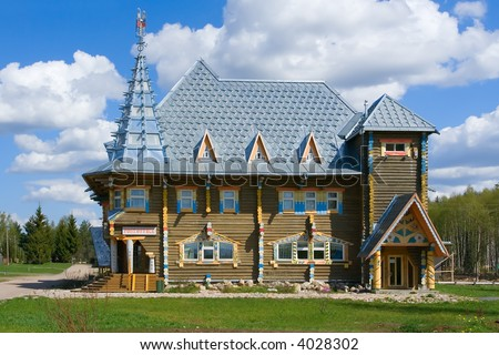 The beautiful house on a background of the blue sky - stock photo
