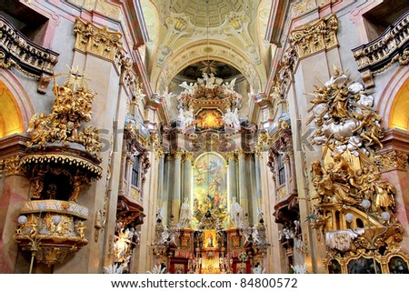 The beautiful interior of St. Peter's Church (Peterskirche), a Baroque Roman Catholic parish church in Vienna, Austria. Inspired by the St Peter's Basilica in Rome, the building was completed in 1733. - stock photo