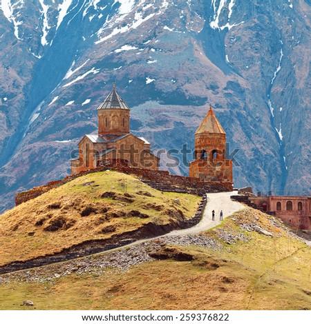 The Beautiful landscape with church near Kazbegi, Georgia, Caucasus. - stock photo