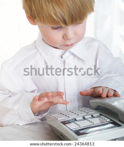 The beautiful little boy represents the businessman at office