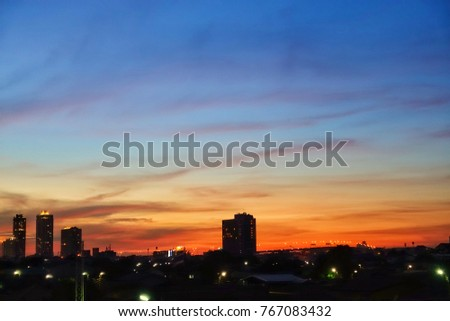 the beautiful orange and blue colors of a sunset. sky is  clear and colour of clouds can be red ,orange and blue.