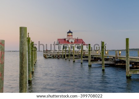 The Beautiful Roanoke Marsh Lighthouse located on the Outer Banks of North Carolina at sunset - stock photo