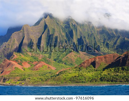 The beautiful, rugged Na Pali Coast and blue ocean of Kauai, Hawaii - stock photo
